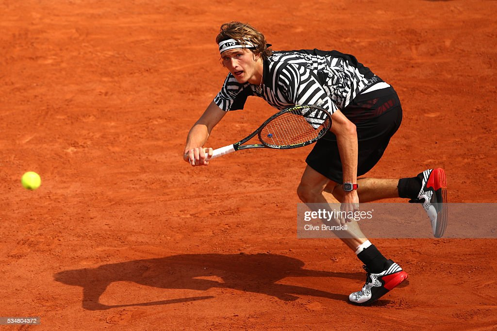 Alexander Zverev of Germany hits a forehand during the Men's Singles third round match against Dominic Thiem of Austria on day seven of the 2016 French Open at Roland Garros on May 28, 2016 in Paris, France.