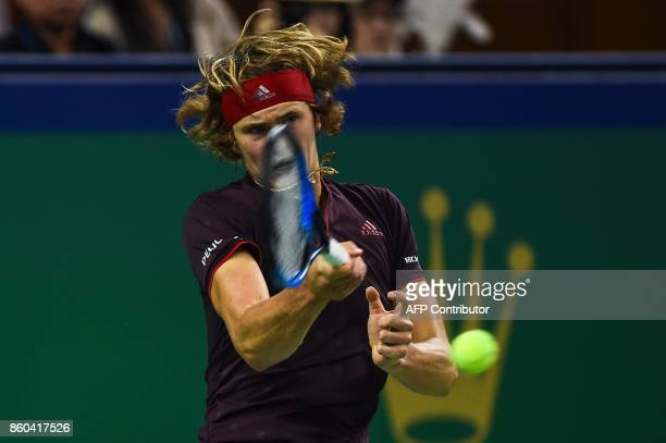 Alexander Zverev of Germany hits a return against Juan Martin del Potro of Argentina during their men's third round singles match at the Shanghai...