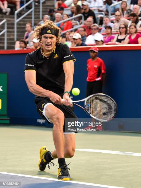 Alexander Zverev of Germany hits a return against Nick Kyrgios of Australia during day seven of the Rogers Cup presented by National Bank at Uniprix...