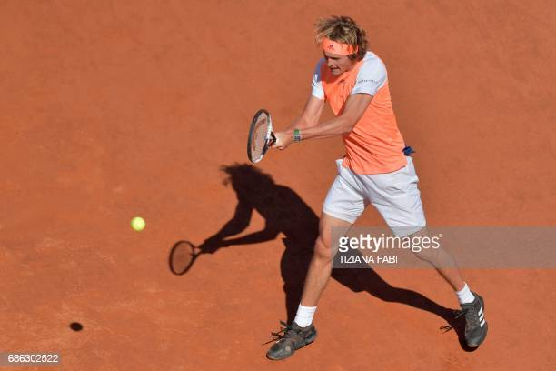Alexander Zverev of Germany hits a return to Novak Djokovic of Serbia during the ATP Tennis Open final at the Foro Italico on May 21 2017 in Rome /...