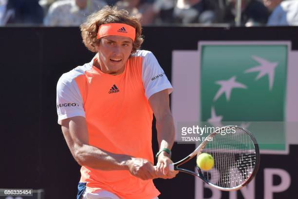 Alexander Zverev of Germany hits a return to Novak Djokovic of Serbia during the ATP Tennis Open final on May 21 2017 at the Foro Italico in Rome...