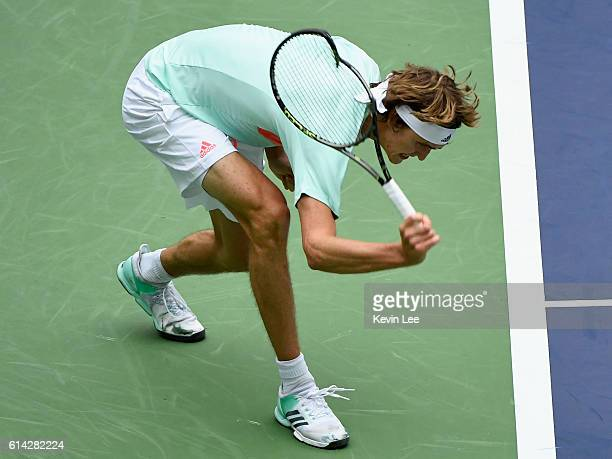 Alexander Zverev of Germany hits the ground with his racket during the Men's singles third round match against JoWilfried Tsonga of France on day...