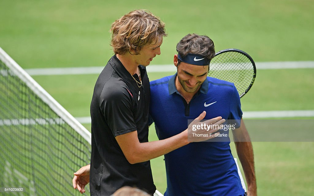 Alexander Zverev of Germany hugs Roger Federer of Switzerland after winning his half final match during day six of the Gerry Weber Open at Gerry...