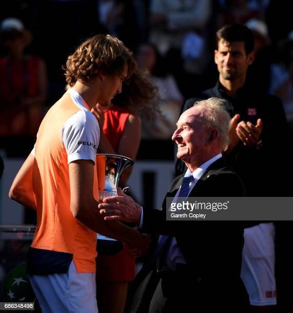Alexander Zverev of Germany is presented with the trophy by Rod Laver after beating Novak Djokovic of Serbia during the final of The Internazionali...