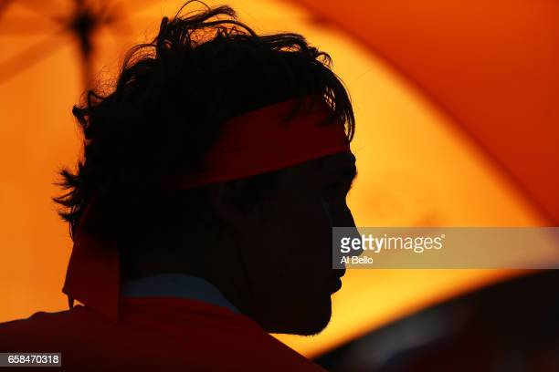 Alexander Zverev of Germany looks on against John Isner during Day 8 of the Miami Open at Crandon Park Tennis Center on March 27 2017 in Key Biscayne...