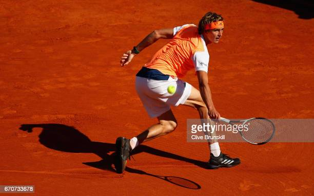 Alexander Zverev of Germany plays a backhand against Rafael Nadal of Spain in his third round match on day five of the Monte Carlo Rolex Masters at...