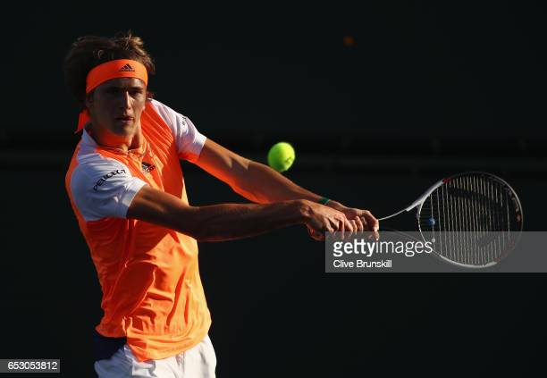 Alexander Zverev of Germany plays a backhand during his doubles match with brother Mischa Zverev against Henri Kontinen of Finland and John Peers of...