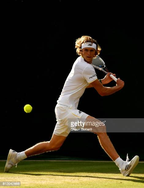 Alexander Zverev of Germany plays a backhand during the Gentlemen's Singles fourth round match against Milos Raonic of Canada on day seven of the...
