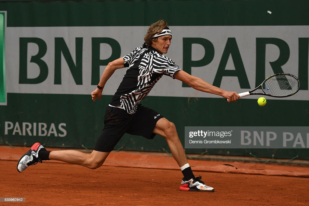 <a gi-track='captionPersonalityLinkClicked' href=/galleries/search?phrase=Alexander+Zverev+-+Tennisser&family=editorial&specificpeople=11367343 ng-click='$event.stopPropagation()'>Alexander Zverev</a> of Germany plays a backhand during the Men's Singles first round match against Pierre-Hughes Herbert of France on day three of the 2016 French Open at Roland Garros on May 24, 2016 in Paris, France.