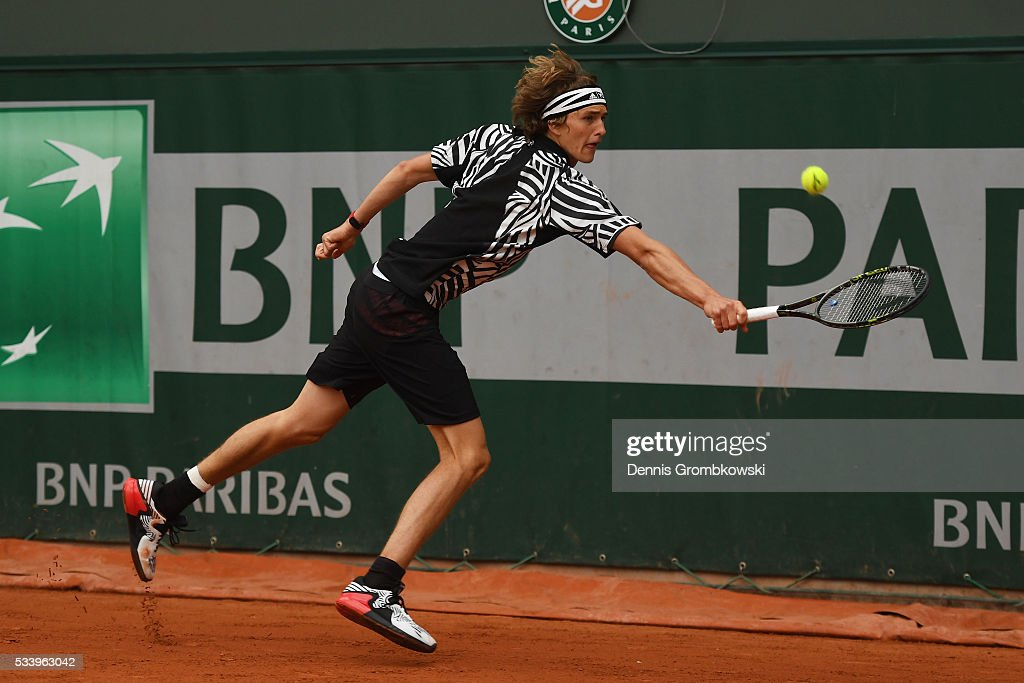 <a gi-track='captionPersonalityLinkClicked' href=/galleries/search?phrase=Alexander+Zverev+-+Tennista&family=editorial&specificpeople=11367343 ng-click='$event.stopPropagation()'>Alexander Zverev</a> of Germany plays a backhand during the Men's Singles first round match against Pierre-Hughes Herbert of France on day three of the 2016 French Open at Roland Garros on May 24, 2016 in Paris, France.