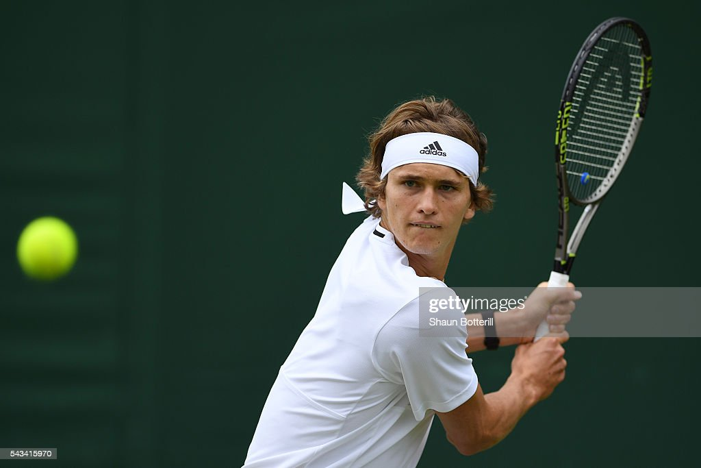 Alexander Zverev of Germany plays a backhand during the Men's Singles first round match against Paul Henri-Mathieu of France on day two of the Wimbledon Lawn Tennis Championships at the All England Lawn Tennis and Croquet Club on June 28, 2016 in London, England.