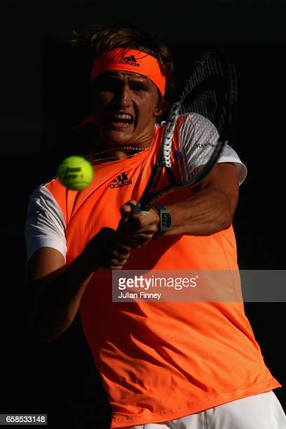 Alexander Zverev of Germany plays a backhand in his match against John Isner of USA at Crandon Park Tennis Center on March 27 2017 in Key Biscayne...