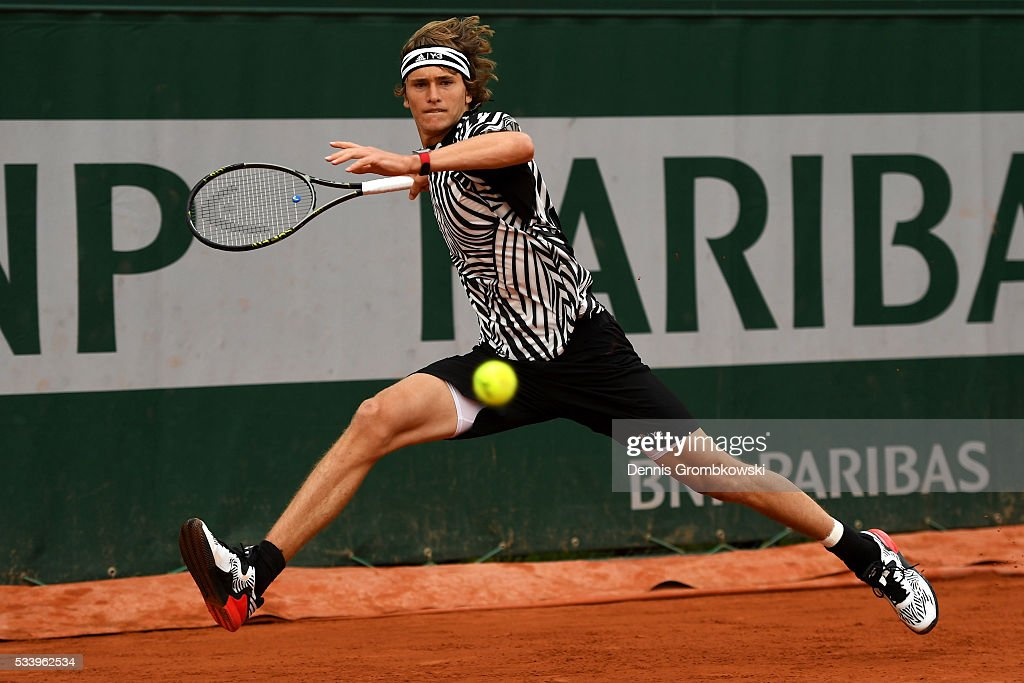 Alexander Zverev of Germany plays a forehand during the Men's Singles first round match against Pierre-Hughes Herbert of France on day three of the 2016 French Open at Roland Garros on May 24, 2016 in Paris, France.
