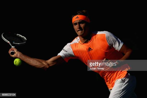 Alexander Zverev of Germany plays a forehand in his match against John Isner of USA at Crandon Park Tennis Center on March 27 2017 in Key Biscayne...