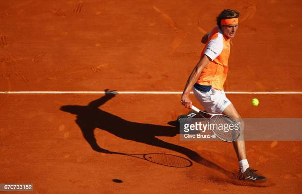 Alexander Zverev of Germany plays a forehand volley against Rafael Nadal of Spain in his third round match on day five of the Monte Carlo Rolex...