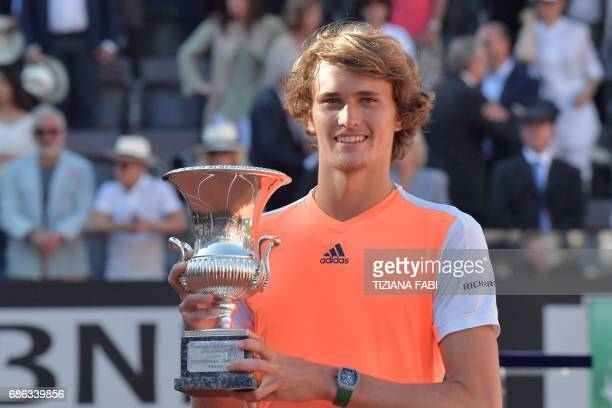 TOPSHOT Alexander Zverev of Germany poses with the trophy after winning the ATP Tennis Open final against Novak Djokovic of Serbia on May 21 at the...