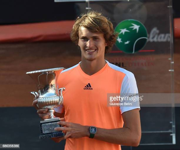 Alexander Zverev of Germany poses with the trophy after winning the ATP Singles Final match between Alexander Zverev of Germany and Novak Djokovic of...