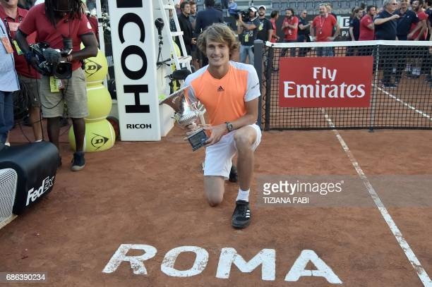 Alexander Zverev of Germany poses with the trophy after winning the ATP Tennis Open final against Novak Djokovic of Serbia on May 21 2017 at the Foro...