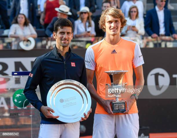 Alexander Zverev of Germany poses with the trophy after winning the ATP Tennis Open final against Novak Djokovic of Serbia on May 21 at the Foro...