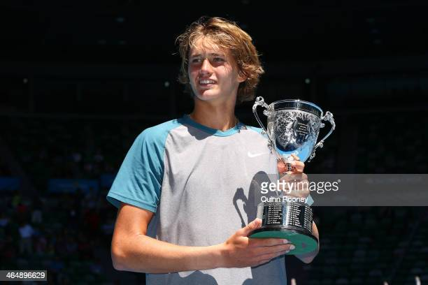 Alexander Zverev of Germany poses with the winners trophy after winning his Junior Boys' Singles Final against Stefan Kozlov of the United States...