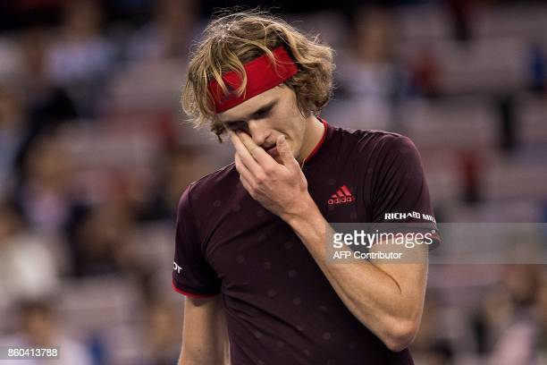 Alexander Zverev of Germany reacts after losing a point against Juan Martin del Potro of Argentina during their men's third round singles match at...