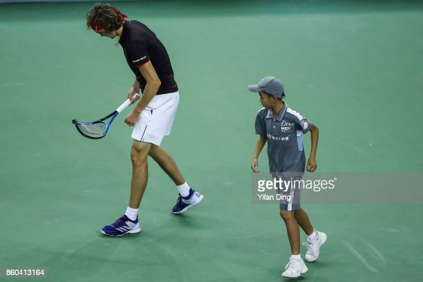 Alexander Zverev of Germany reacts after trampling his racket during the Men's singles mach against JuanMartin Del Potro of Argentina on day 5 of...