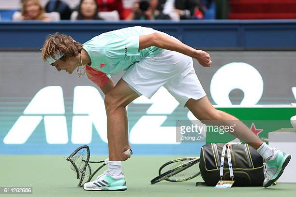 Alexander Zverev of Germany reacts by crashing his racquet the match against JoWilfried Tsonga of France on Day 5 of the ATP Shanghai Rolex Masters...