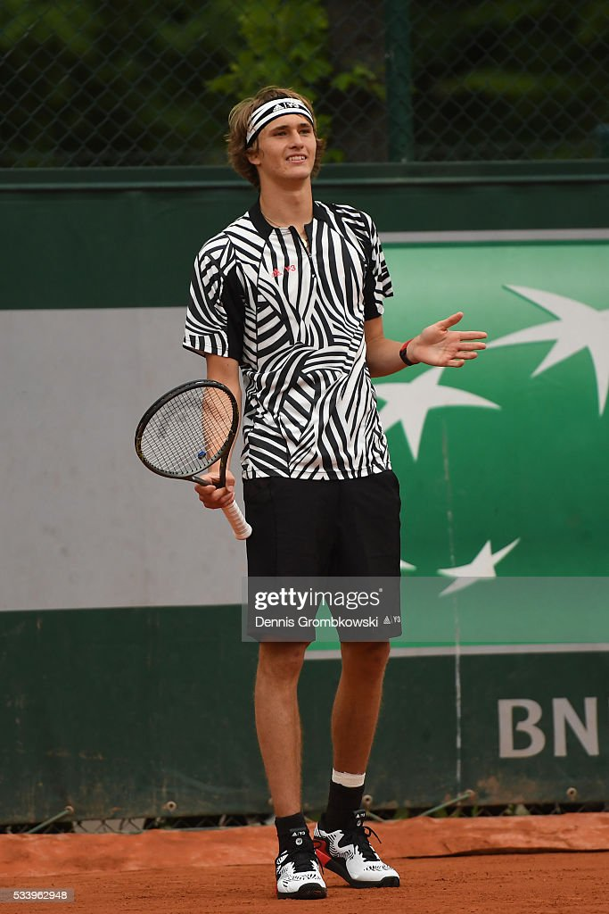 <a gi-track='captionPersonalityLinkClicked' href=/galleries/search?phrase=Alexander+Zverev+-+Tennisser&family=editorial&specificpeople=11367343 ng-click='$event.stopPropagation()'>Alexander Zverev</a> of Germany reacts during the Men's Singles first round match against Pierre-Hughes Herbert of France on day three of the 2016 French Open at Roland Garros on May 24, 2016 in Paris, France.