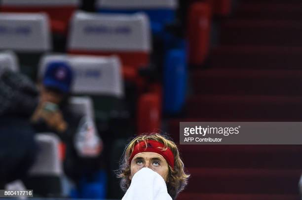 Alexander Zverev of Germany rests during a break in his men's third round singles match against Juan Martin del Potro of Argentina at the Shanghai...