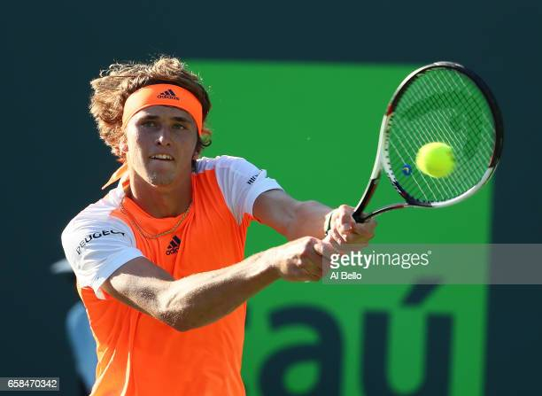 Alexander Zverev of Germany returns a shot against John Isner during Day 8 of the Miami Open at Crandon Park Tennis Center on March 27 2017 in Key...