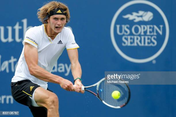 Alexander Zverev of Germany returns a shot to Frances Tiafoe of the United States during Day 5 of the Western and Southern Open at the Lindner Family...