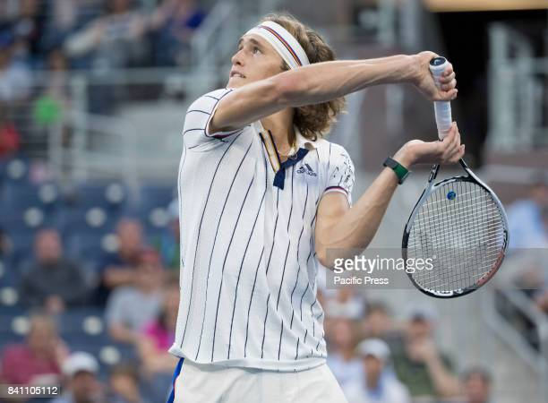 Alexander Zverev of Germany returns ball during match against Borna Coric of Croatia at US Open Championships at Billie Jean King National Tennis...