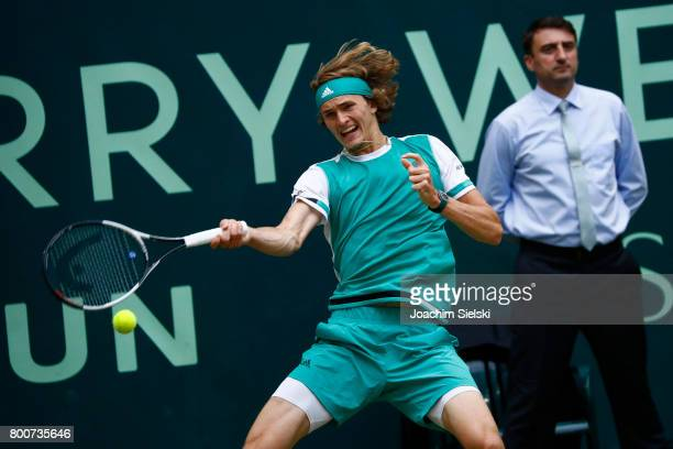 Alexander Zverev of Germany returns the ball during the men's singles match against Roger Federer of Suiss on Day 9 of the Gerry Weber Open 2017 at...
