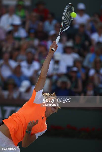 Alexander Zverev of Germany serves against Nick Kyrgios of Australia in their third round match during day nine of the BNP Paribas Open at Indian...