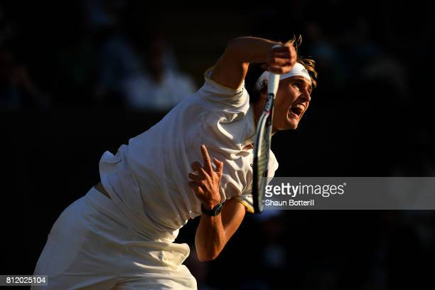 Alexander Zverev of Germany serves during the Gentlemen's Singles fourth round match against Milos Raonic of Canada on day seven of the Wimbledon...