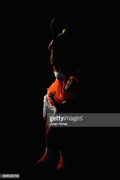 Alexander Zverev of Germany serves to John Isner of USA at Crandon Park Tennis Center on March 27 2017 in Key Biscayne Florida