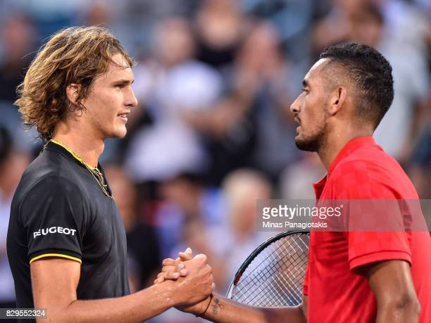 Alexander Zverev of Germany shakes hands with Nick Kyrgios of Australia during day seven of the Rogers Cup presented by National Bank at Uniprix...