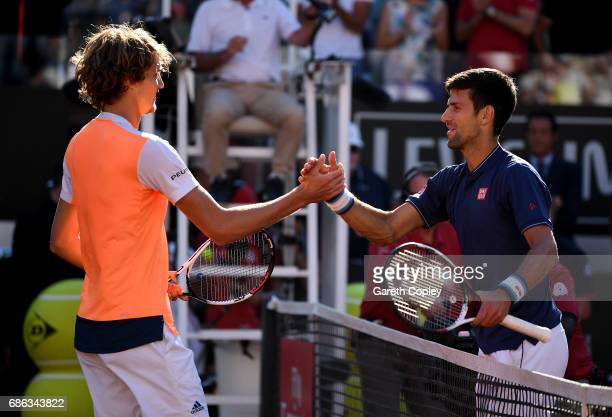 Alexander Zverev of Germany shakes hands with Novak Djokovic of Serbia after beating him during the final of The Internazionali BNL d'Italia 2017 at...