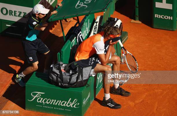 Alexander Zverev of Germany shows his dejection after smashing his racket during his straight set defeat by Rafael Nadal of Spain in his third round...