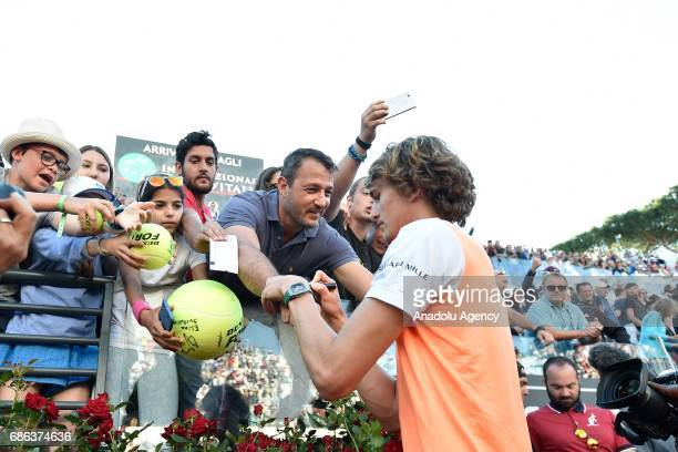 Alexander Zverev of Germany signs autographs for fans after winning the Men's Single Final match against Novak Djokovic of Serbia during day eight of...