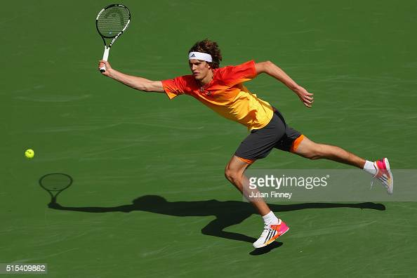 Alexander Zverev of Germany stretches for a forehand in his match against Grigor Dimitrov of Bulgaria during day seven of the BNP Paribas Open at...