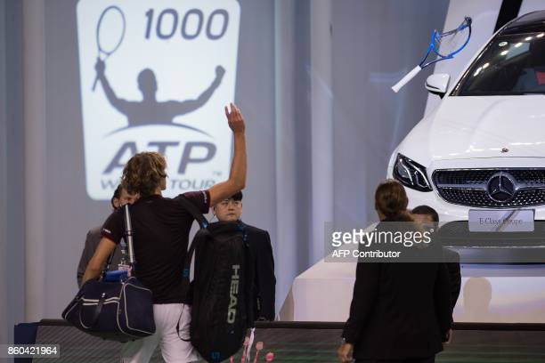 Alexander Zverev of Germany throw his broken racquet to the crowd after losing his men's third round singles match against Juan Martin Del Potro of...
