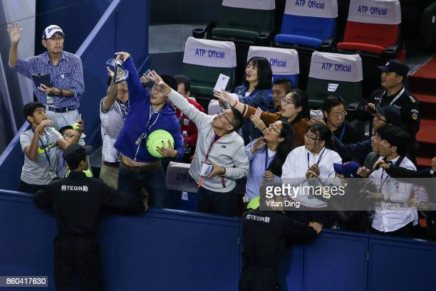Alexander Zverev of Germany throws his damaged racket to the audience after losing the Men's singles mach against JuanMartin Del Potro of Argentina...