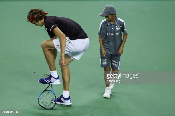 Alexander Zverev of Germany tramples his racket during the Men's singles mach against JuanMartin Del Potro of Argentina on day 5 of 2017 ATP Shanghai...