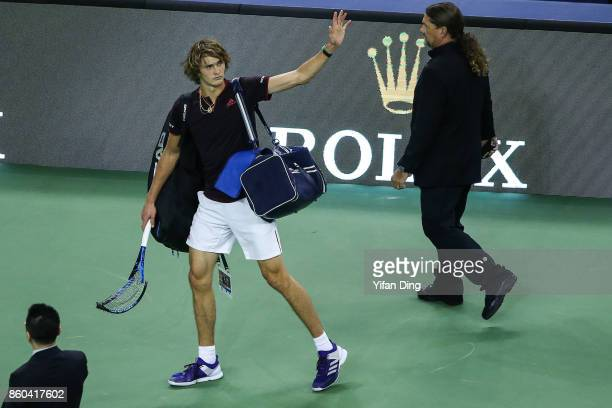 Alexander Zverev of Germany waves to the audience with his damaged raket after losing the Men's singles mach against JuanMartin Del Potro of...