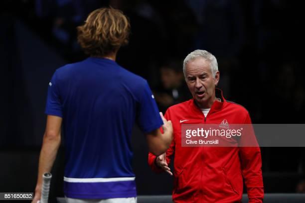 Alexander Zverev of Team Europe shakes hands at the net with John Mcenroe Captain of Team World after winning his singles match against Denis...