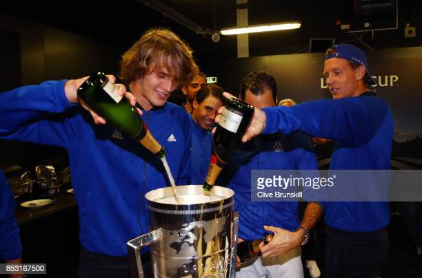 Alexander Zverev Rafael Nadal Roger Federer and Tomas Berdych of Team Europe drink champagne after winning the Laver Cup on the final day of the...