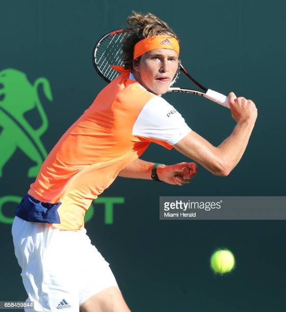 Alexander Zverev returns a ball hit by John Isner at the Miami Open on Monday March 27 2017 on Key Biscayne Fla