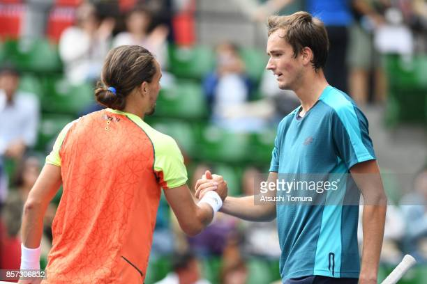 Alexandr Dolgopoloc of Ukraine and Daniil Medvedev of Russia shake hands after their match during day three of the Rakuten Open at Ariake Coliseum on...