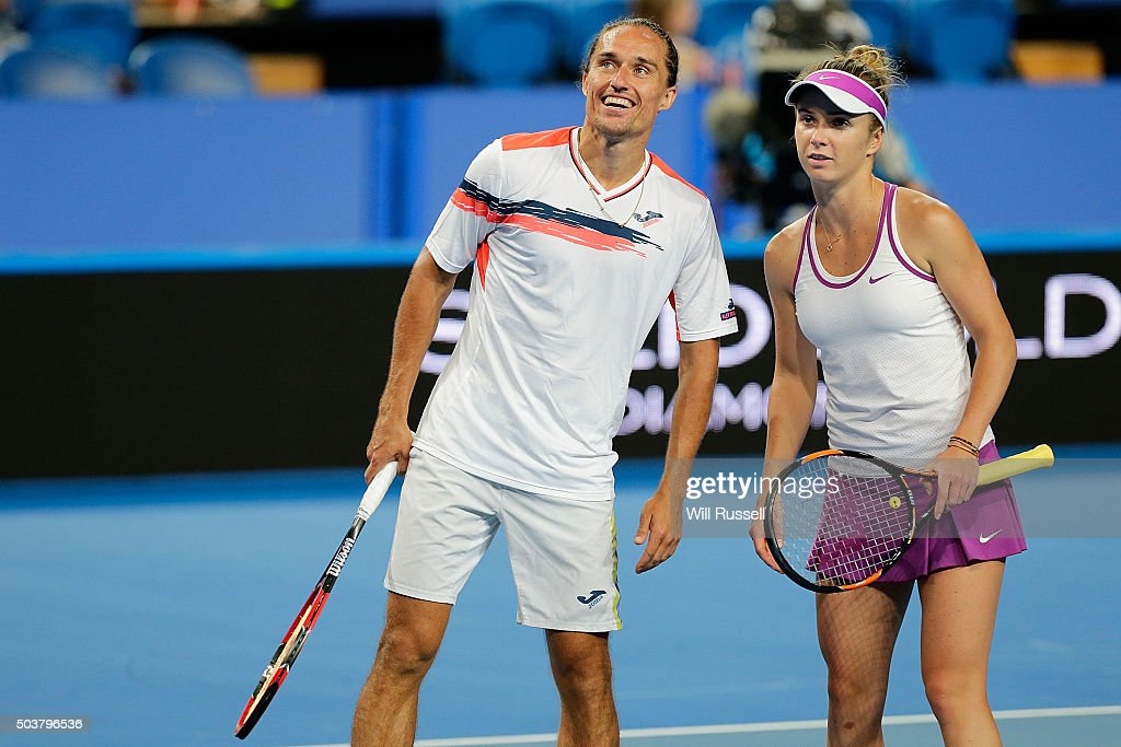 Alexandr Dolgopolov and Elina Svitolina of the Ukraine look up at the replay screen in the mixed doubles match against Jarmila Wolfe and Lleyton...